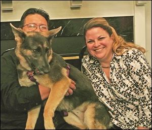 Special guest Dakota and her adoptive parents Dave and Meg Avalos during the Paw Hoorah! fund-raiser.