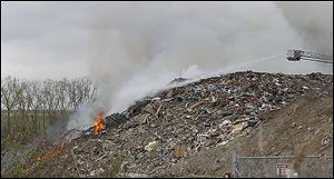 Toledo firefighters work earlier this month to extinguish the fire that broke out at Stickney Recycling, a construction and demolition debris landfill in North Toledo.