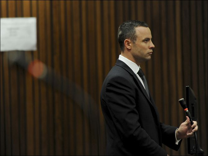 South Africa Pistorius Trial Oscar Pistorius stands in the dock at the high court in Pretoria, South Africa, today. The judge overseeing the murder trial of Pistorius on Wednesday ordered the double-amputee athlete to undergo psychiatric tests, meaning that the trial proceedings will be delayed.