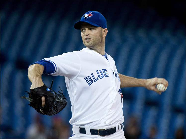 Toronto Blue Jays starting pitcher J.A. Happ works against the Cleveland Indians.