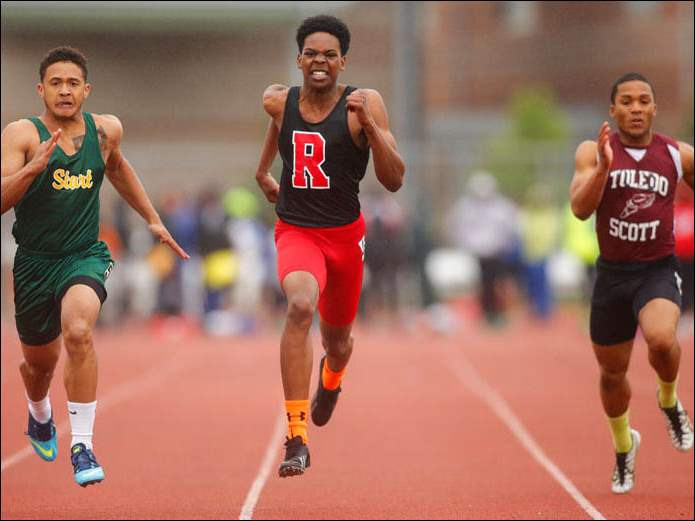 From left, Start's Damar Ellis, Rogers' John Gauldin, and Scott's Marvin Gardner race in the 100-meter dash at the City League track and field championships on Thursday afternoon at Rogers. Start won the boys team race with 154 points. Ellis swept the 100 and 200-meter events.