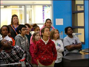 Visiting students from Jones Elementary School watch the