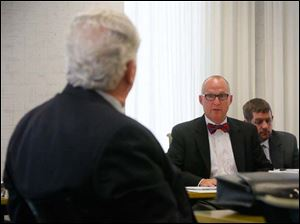 Scott Borgemenke, right, from the state transparency committee, addresses board chairman Ron Rothenbuhler.