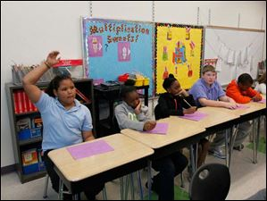 Jones Elementary School fourth graders tell Marshall fourth graders of the special activities at their school. From left: Kayla Burwell, Ti'Ona Hill, Diamond Jones, Shannon Bryant, and Chris Robinson.