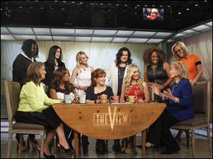 "Standing from left, Whoopi Goldberg, Lisa Ling, Elisabeth Hasselbeck, Rosie O'Donnell Sherri Shepherd and Jenny McCarthy, and seated from left, Meredith Vieira, Star Jones, Joy Behar, Debbie Matenopoulos and Barbara Walters on Thursday on the set of the daytime talk series ""The View."""