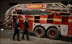 President Obama and former New York City Mayor Michael Bloomberg tour the destroyed Ladder 3 truck at the September 11 Memorial Museum.