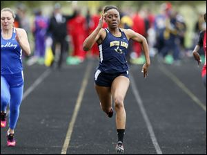 Chanatlia Young of Notre Dame, center, wins the 100 meter dash.