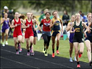 Oregon Clay's Haley Hess, front left, and Erin Gyurke, front right, take first and second respectively in the 1600 meter run.