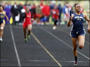 Chanatlia Young of Notre Dame runs the final leg of the 4X200 meter relay.
