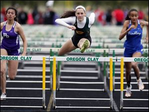 Grace Winckowski of Oregon Clay wins the 100 meter hurdles.