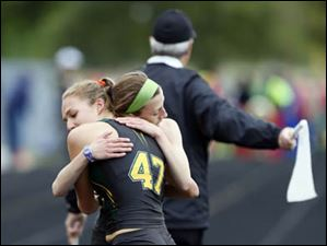 Oregon Clay's Haley Hess, left, and Erin Gyurke, right, took first and second respectively in the 1600 meter run.