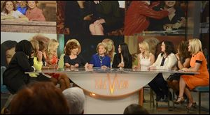 Past and present 'View'co-hosts, from left, Whoopi Goldberg, Meredith Vieira, Star Jones, Debbie Matenopoulos, Joy Behar, Barbara Walters, Lisa Ling, Elisabeth Hasselbeck, Rosie O'Donnell, Sherri Shepherd, and Jenny McCarthy chat on the set of the daytime talk show in New York.