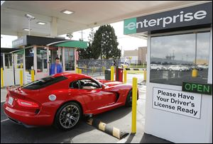 A renter checks out a 2013 Dodge Viper at the Enterprise Exotic Car Collection showroom near Los Angeles. Enterprise moved into the exotics market in 2006 after customers started asking for rarer models.