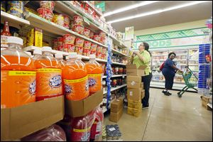 Manager Maryann Bartel stocks shelves at Dollar Tree on Sylvania and Monroe, the former location of a CVS Pharmacy.