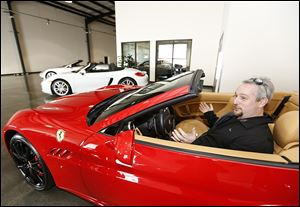 Steve Briscoe reacts after starting the motor of a 2014 Ferrari California displayed for rent at the Enterprise Exotic Car Collection showroom near Los Angeles International Airport.