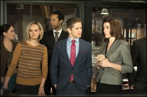 "Front row from left,  Jess Weixler, Matt Czuchry, and Julianna Margulies in a scene from ""The Good Wife."""