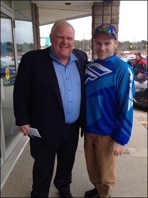 Toronto Mayor Rob Ford is still in rehab, his lawyer said Friday as photos of the mayor posing with residents in Ontario's cottage country were posted online.
