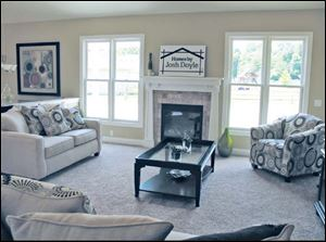 This comfortable great room includes a Craftsman-style fireplace.