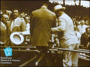 A still from the video of FDR at the 1937 All-Star Game at Griffith Park in Washington shows the polio-stricken 32nd president being helped from the field to his seat.