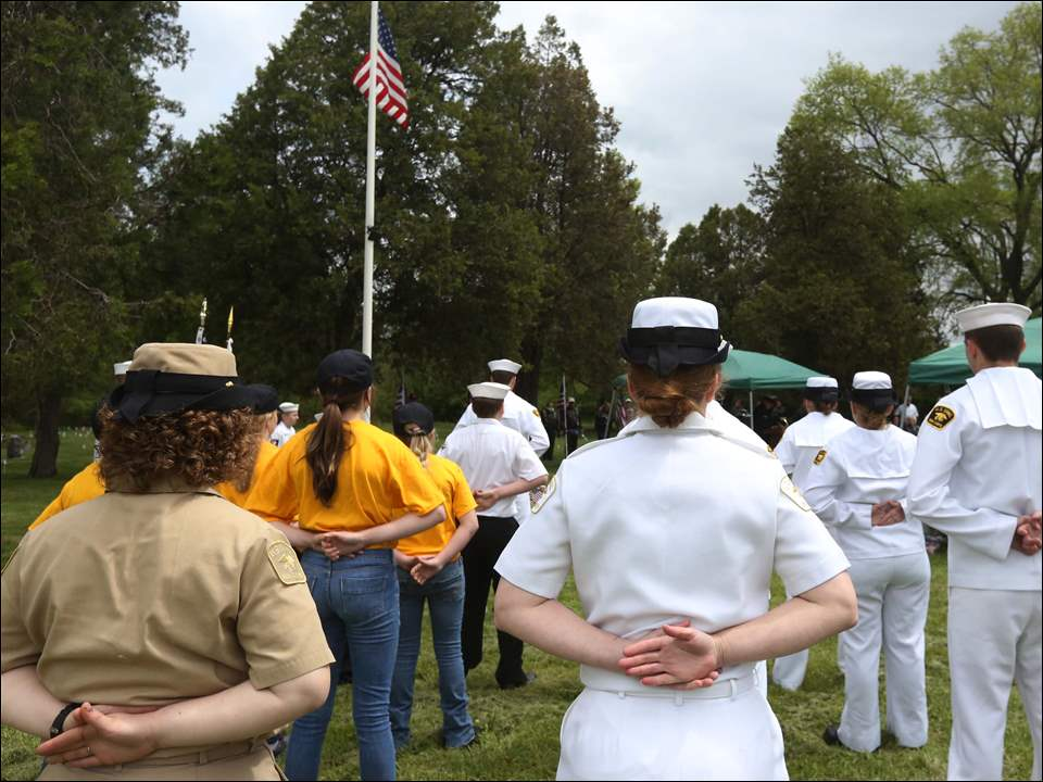 US Navel Sea Cadets stand together during the 7th Annual Veteran's Memorial Program in the former Toledo State Hospital Cemetery behind Bowsher High School in South Toledo.