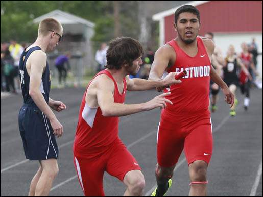Eastwood's Gabe Fredericks grabs the baton from Joe Salinas in the 4x400 meter relay.