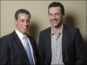 J. B. Bernstein poses with Jon Hamm, who plays him in the film 'Million Dollar Arm.'