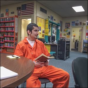 Inmate Federico Ortiz says of the Lucas County Jail's library: 'It feels good to come down here, check out some books, and relax.' He wrote a poem for which he won a contest at the jail this year.