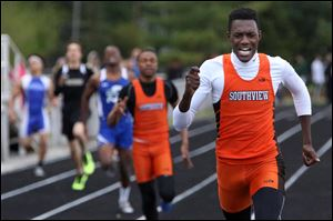 Southview's senior J.J. Pinckney crosses the finish line first in the 400 meter dash of the NLL meet.