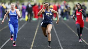 Chanatlia Young of Notre Dame, center, wins the 100 meter dash during the TRAC meet.