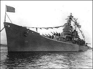 The first USS Toledo, moored in Japan in 1950, was a heavy cruiser. Its construction began in 1943 and finished in 1946. It was one of the first U.S. warships deployed to Korea after the 1950 invasion by the North.