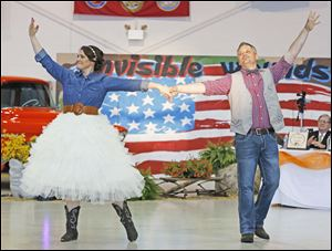 "Jason Tucker and Janelle Tucker dance the tribute dance during ""Dancing with the Military Stars."""