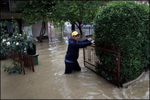 Rain-swollen rivers across the Balkans have flooded roads, cut off power and caused more than 200 landslides.
