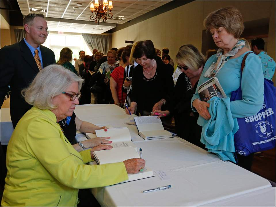 Rebecca Eaton, front left, signs copies of her book. Also photographed are Darren LaShelle, left, director of content for WGTE, and right, from front, are Linda Furney, Sharon Dickerson, and Susan Darmofal, all of Toledo.