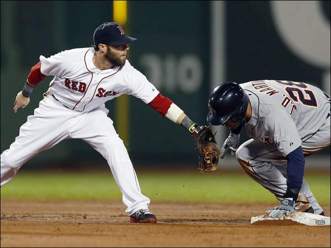 Boston Red Sox's Dustin Pedroia, left, puts a late tag on Detroit Tigers' J.D. Martinez.