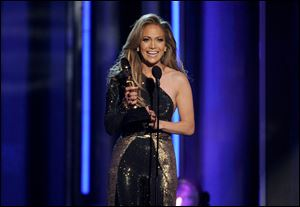 Jennifer Lopez accepts the icon award at the Billboard Music Awards.