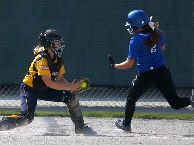 Notre Dame catcher Nicole Bakken tags out Anthony Wayne's Mac Rhodes on an attempted home plate steal in the 1st inning.