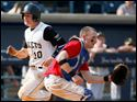 Perrysburg's Zach Honsberger scores against Springfield catcher Devin Burns during the fourth inning.