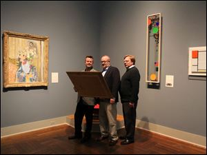 From left, John Duvall, Paul Causman, and Bill Quinlan rehearse at the Toledo Museum of Art for a staged reading of the award-winning drama 'Art' at 7 p.m. May 29 in the museum's Little Theater. Admission is free.