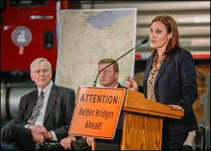 Ohio  Lt. Gov. Mary Taylor announced the bridge improvement projects for Lucas and Wood counties on Tuesday. Looking on are Raymond Huber, left, Wood County engineer, and Todd Audet, deputy
