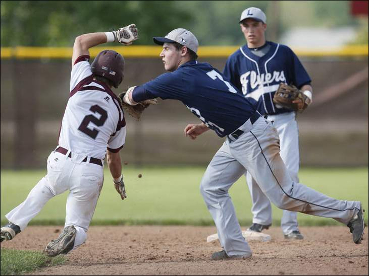 Genoa's Casey Gose (2) is tagged out by   Lake's Adam Duncan (7).