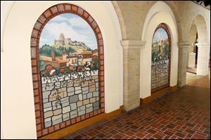Sister Jane Mary Sorosiak created these two ceramic tile and acrylic murals for Lourdes University. The two arched murals depict views of Assisi, where St. Francis founded three orders.
