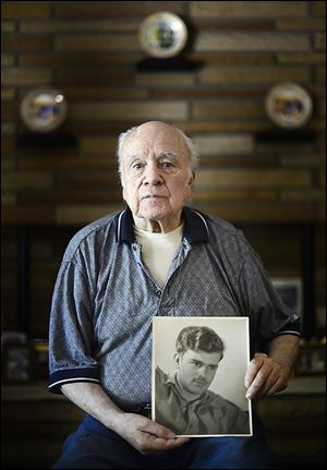 Billy Power holds a photo of Cpl. Harold W. Reed, who was killed in 1950 in the battle at Chosin Reservoir. Mr. Power too served in Korea and had promised Corporal Reed that he'd bring him home.