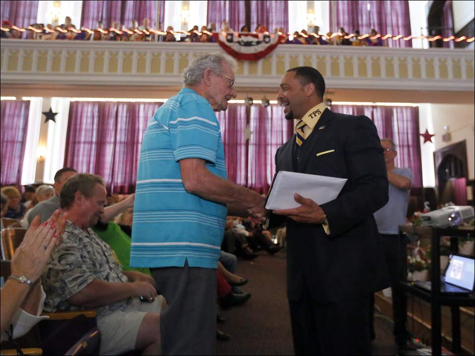 Vic Kretz, left, from North Baltimore, receives his Waite High School diploma from Romules Durant, TPS Superintendent.