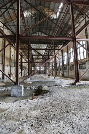 The cavernous interior of the former Toledo Edison Steam Plant in downtown Toledo is expected to get new life as ProMedica's headquarters. ProMedica said it would create a multifloor, modern-looking office building inside the former power plant. However, tax credits and adequate parking are two areas that need to be worked out.