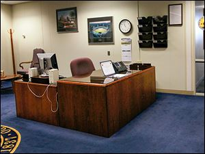 The receptionist's desk is un-attended Friday outside the mayor's office at One Government Center.
