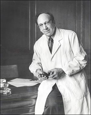 Paul Block, Jr., shown with a model of a thyroid compound, was a research chemist who understood the importance of biomedical research, a chief reason he supported the formation of a medical college. Gov. James Rhodes credited Mr. Block as a '‍moving force' behind the establishment of Toledo's medical college.