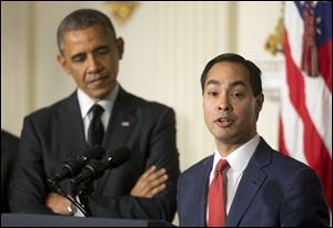 President Barack Obama listens to San Antonio Mayor Julian Castro after announcing the nomination of Castro to lead the Department of Housing and Urban Development today in the State Dinning Room of the White House in Washington.