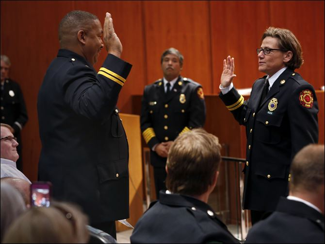 CTY promote23p verdell and marquardt Toledo Fire and Rescue Department Battalion Chief Verdell Franklin swears in the department's newly promoted Deputy Assistant Chief Karen Marquardt during a promotion ceremony at One Government Center.