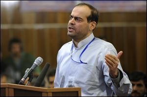Mahafarid Amir Khosravi speaks at his trial in this 2012 file photo.