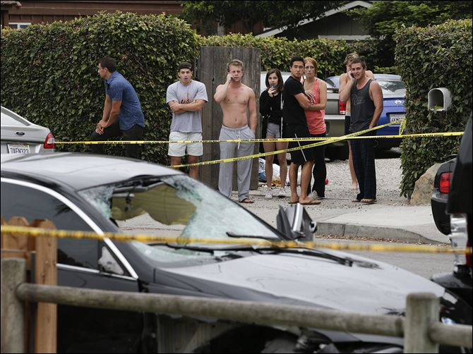 College Community Shooting drive-by Calif. People look at a black BMW sedan driven by a drive-by shooter today in Isla Vista, Calif.